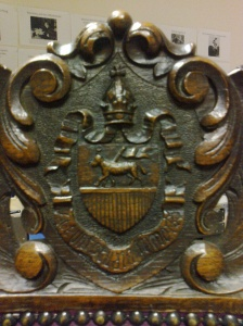 St. John's College's crest at the top of the chair
